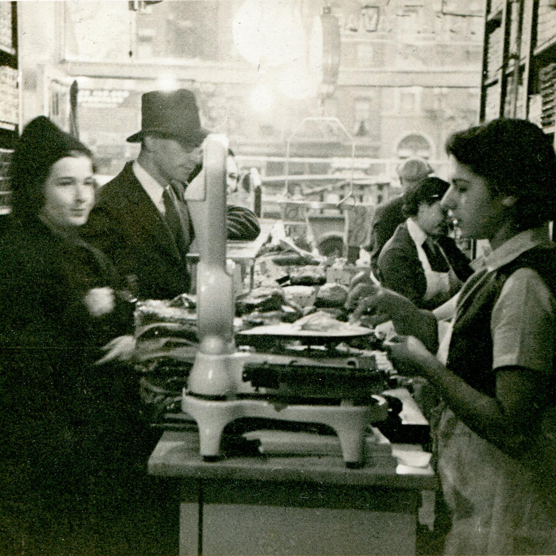 Mark Russ Federman's mother, Anne, serves customers at Russ and Daughters in 1939.