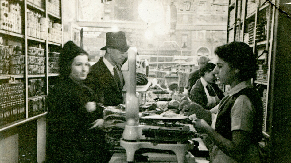 Mark Russ Federman's mother, Anne, serves customers at Russ and Daughters in 1939. (Courtesy of Russ And Daughters)