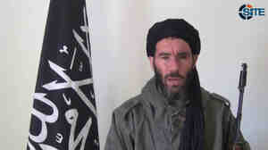 In this image from video, Mokhtar Belmokhtar claims responsibility for a deadly attack on a BP gas facilit