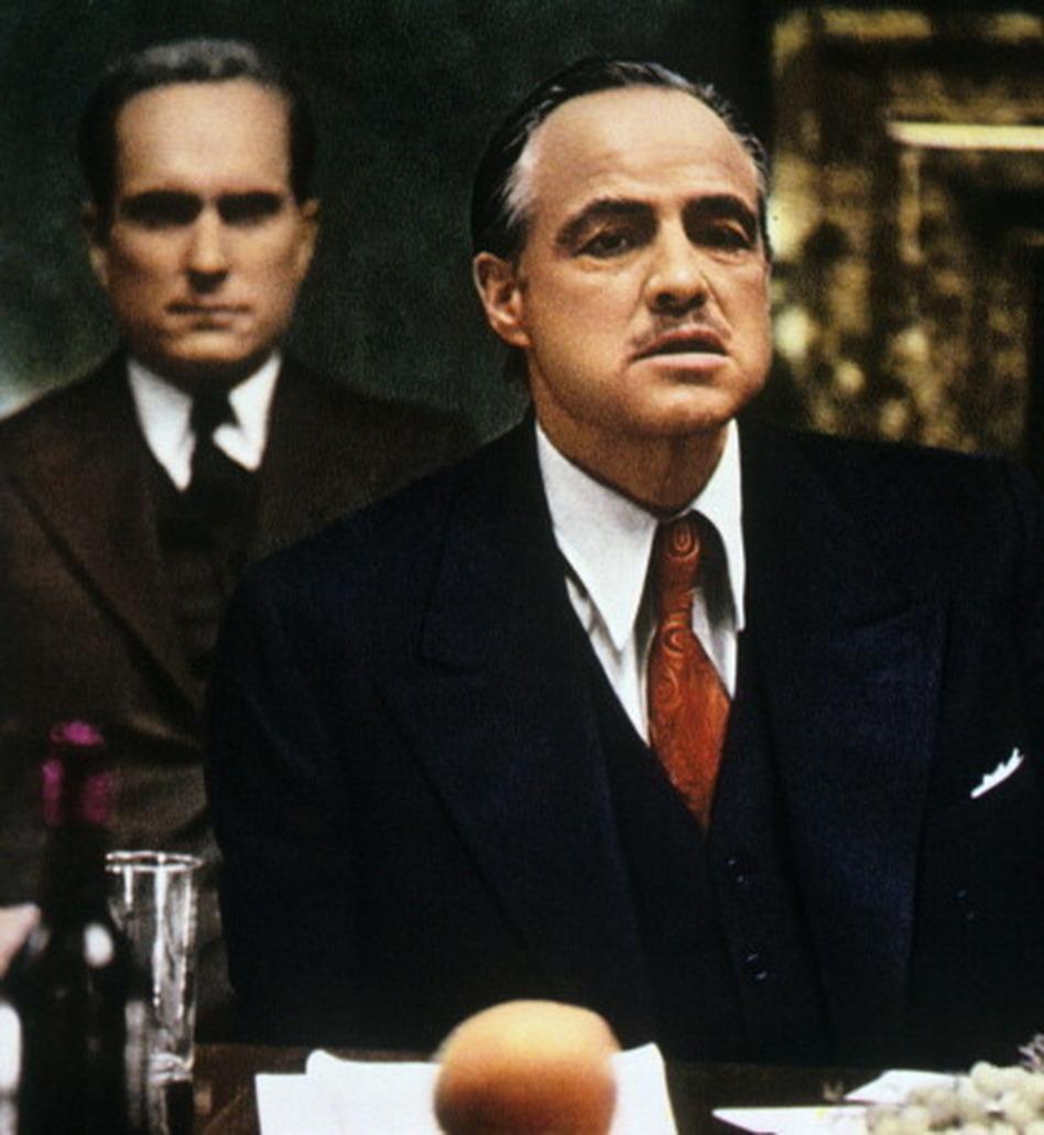 Robert Duvall and Marlon Brando in <em>The Godfather</em>.