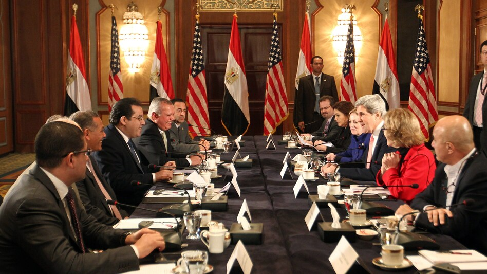 Secretary of State John Kerry (center, right) meets with members of Egyptian political parties in Cairo on Saturday. (AFP/Getty Images)