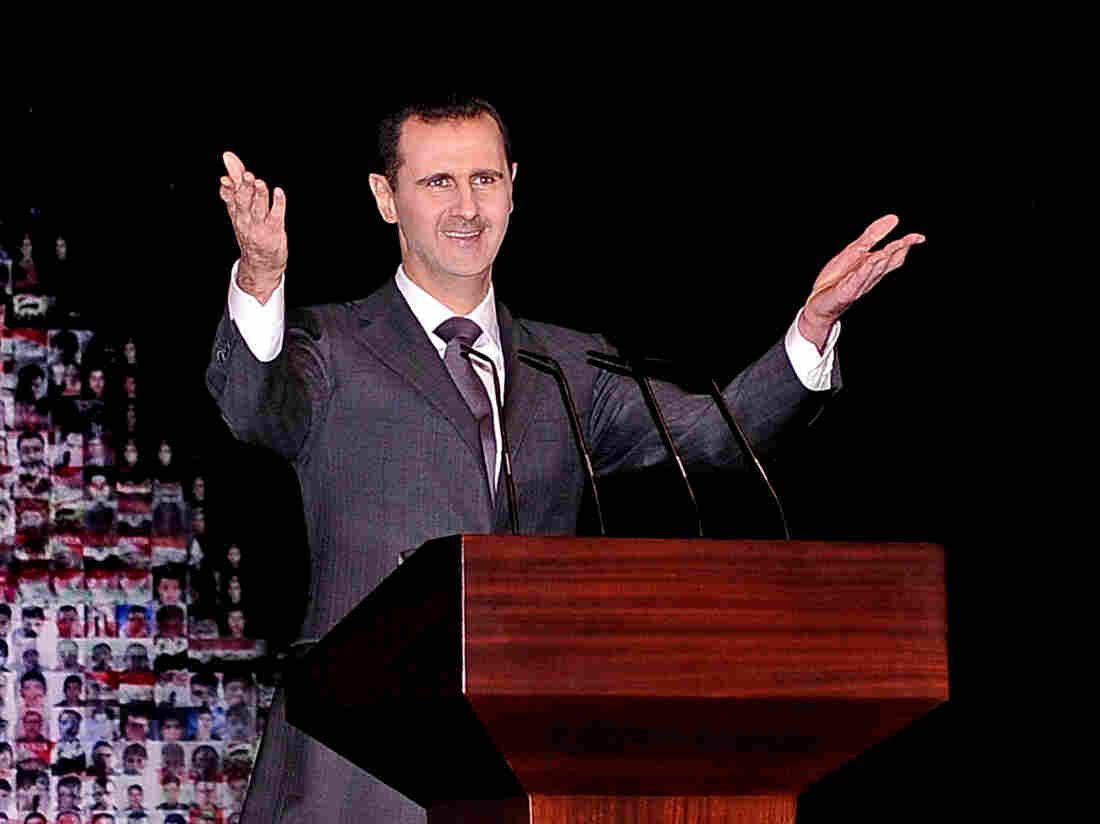 Syrian President Bashar Assad speaks at the Opera House in Damascus, Syria, on Jan. 6. In an interview with Britain's Sunday Times, Assad said that only the Syrian people can tell him when to  go.