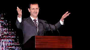 Syrian President Bashar Assad speaks at the Opera House in Damascu