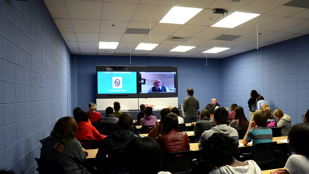 "Students at Westlake High School in Waldorf, Md., participate in an interactive digital conversation with historian Kenneth C. Davis about late 19th and early 20th century American history on Thursday. The school uses a state of the art ""telepresence center"" for students to connect with experts all over the world. (Celeste Headlee)"