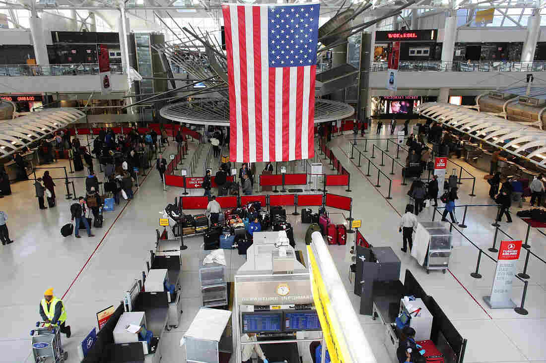 People wait in a security line at John F. Kennedy Airport on February 28, 2013 in New York City.