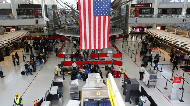 People wait in a security line at John F. Kennedy Airport on February 28, 2013 in New York City. (Getty Images)