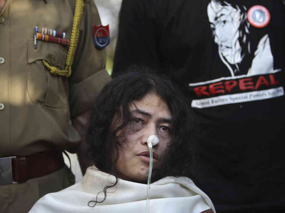 Activist Irom Sharmila is flanked by a policeman, left, and a supporter, on Monday in New Delhi. Sharmila has been on a hunger strike for 12 years to protest an Indian law that suspends many human rights protections in areas of conflict.