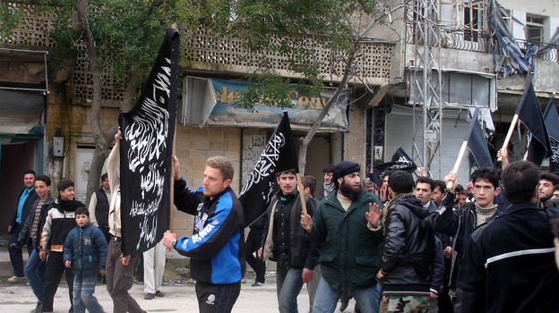 Islamists from Jabhat al Nusra stage their own protest in the town. Until recently, the group has been reluctant to appear in public. (NPR)