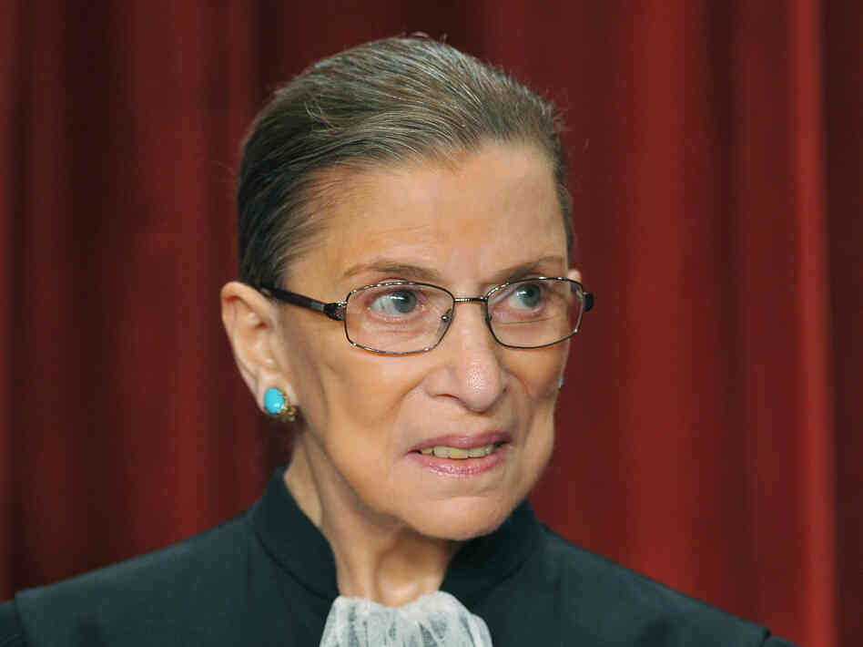 U.S. Supreme Court Justice Ruth Bader Ginsburg poses during a group photo in September 2009 in the East Conference Room of the Supreme Court.