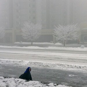 """""""A North Korean woman walks in snowstorm in #Pyongyang. An iPod touch photo from Jan. 13, 2013."""""""