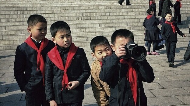 """Posted Feb. 16: """"This little North Korean dude and his school buddies, were playing with one of my cameras this morning at Mansu Hill in #Pyongyang."""" (AP)"""