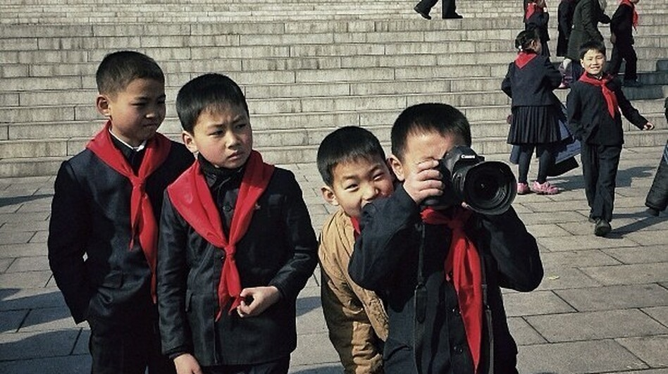 "Posted Feb. 16: ""This little North Korean dude and his school buddies, were playing with one of my cameras this morning at Mansu Hill in #Pyongyang."" (AP)"