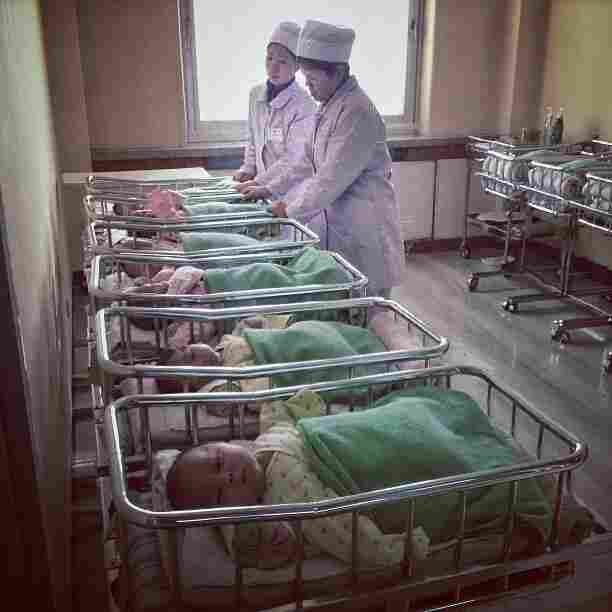 """North Korean babies rest in a row of cribs at the #Pyongyang Maternity Hospital."""