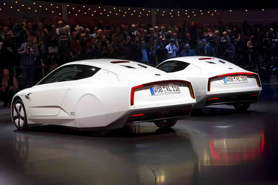 Two new Volkswagen hybrid XL1 model cars are displayed during a preview of Volkswagen ahea