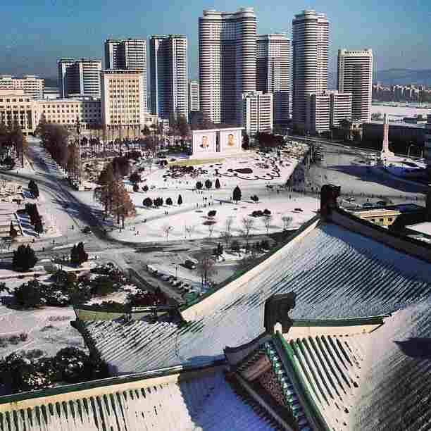 """This is a tourist-like view from a balcony at the Grand People's Study House. The high-rises, behind the mosaics of two Kim's, is the 3,000-unit Changjon Street apartment building complex that was completed last April. iPod touch photo from Jan. 9, 2013."""