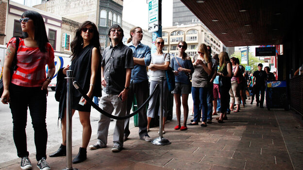 SXSW festival-goers line up at The Parish on Sixth Street in Austin for NPR Music's day party March 15, 2012.