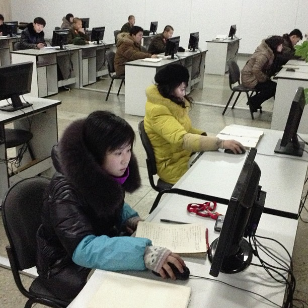 """When Google chairman Eric Schmidt traveled to North Korea in January, I went with him to this massive library in #Pyongyang called The Grand People's Study House and met these students, in winter hats and gloves, working at computers connected to the local intranet. iPod touch photo from Jan. 9, 2013."""