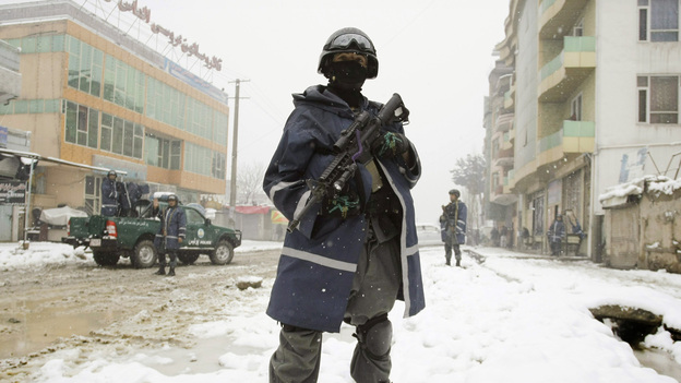 An Afghan policeman stands guard near the scene of a suicide attack in Kabul, Afghanistan, Feb. 27 (AP)