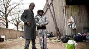 Linwood Hearne, 64, and his wife, Evelyn, 47, stand near Interstate 83 in Baltimore where they slept on and off for the past four years. Increasingly, the nation's homeless population is getting older, sicker and fraught with complex medical conditions.