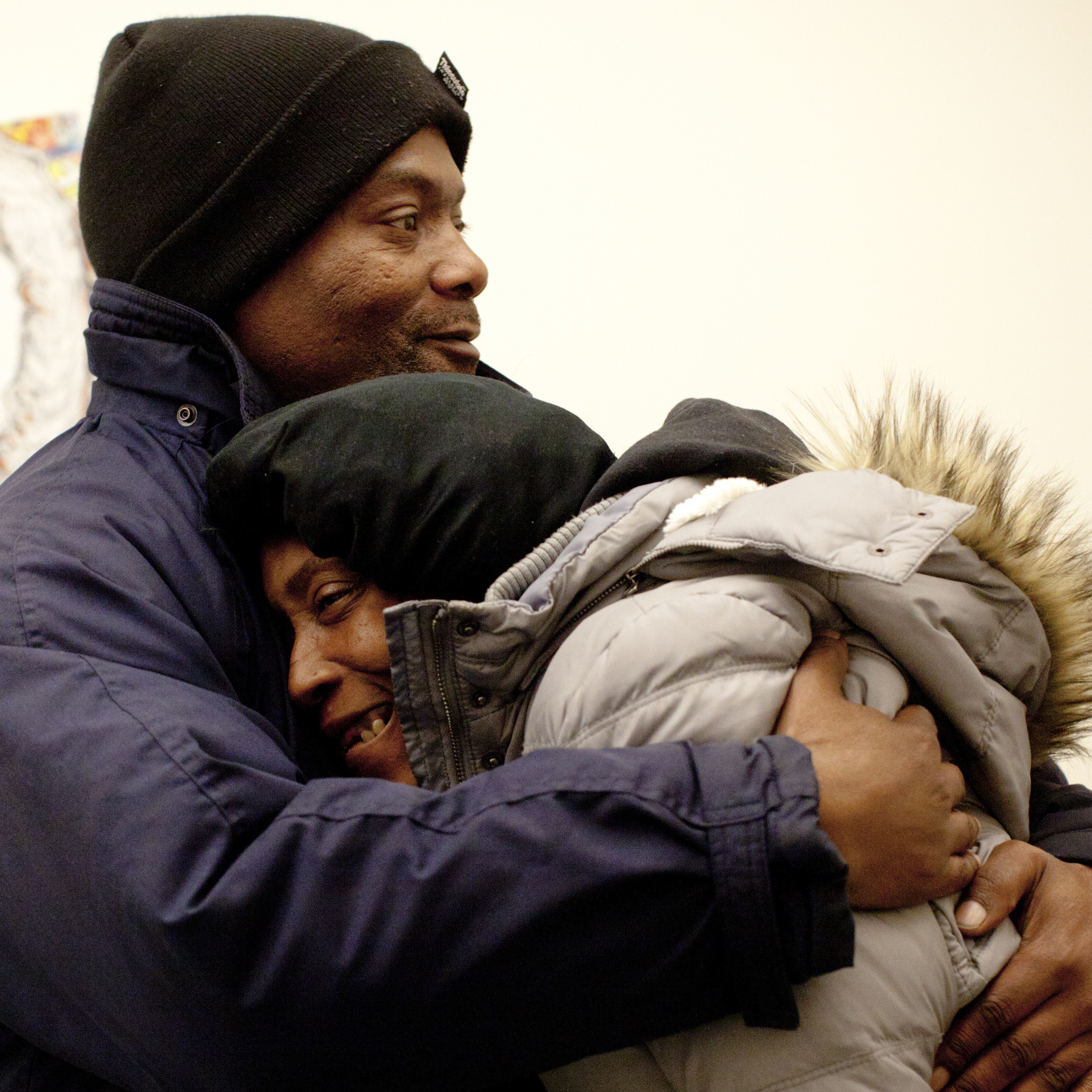 Tony Simmons hugs Evelyn Hearne, who has been homeless for four years, at Baltimore's Health Care for the Homeless. Simmons, homeless for 14 months, is trying to help Hearne and her husband get housing.