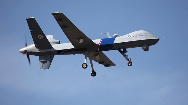 """An unmanned drone patrols the U.S.-Canadian border. Attorney General Eric Holder, in a letter to Sen. Rand Paul, R-Ky., said the president could in an """"extraordinary circumstance"""" order a drone strike inside the country. (AP)"""