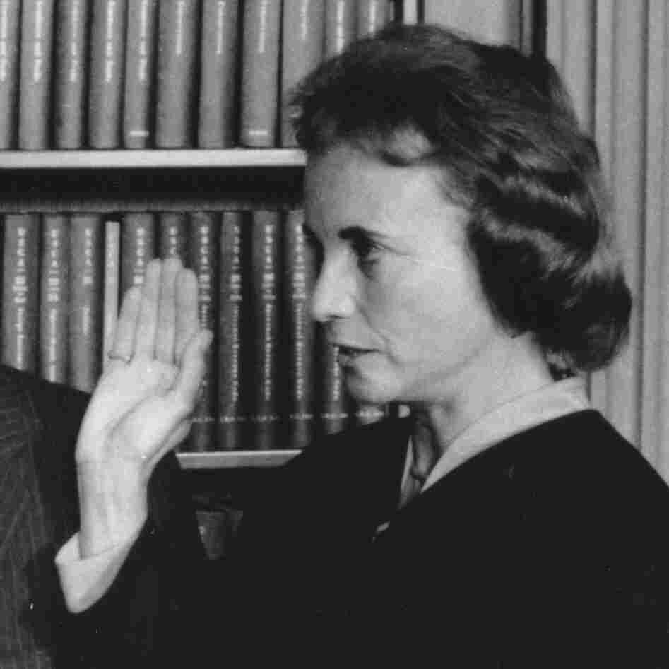 Sandra Day O'Connor is sworn in as an associate justice by Chief Justice Warren Burger on Sept. 25, 1981. Holding two family Bibles is husband John Jay O'Connor.
