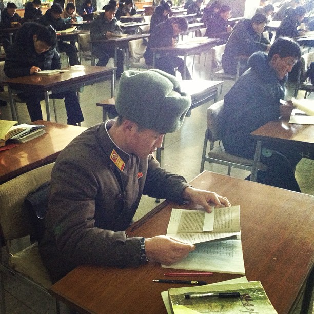 """A North Korean soldier reads at a desk at the Grand People's Study House in #Pyongyang."""