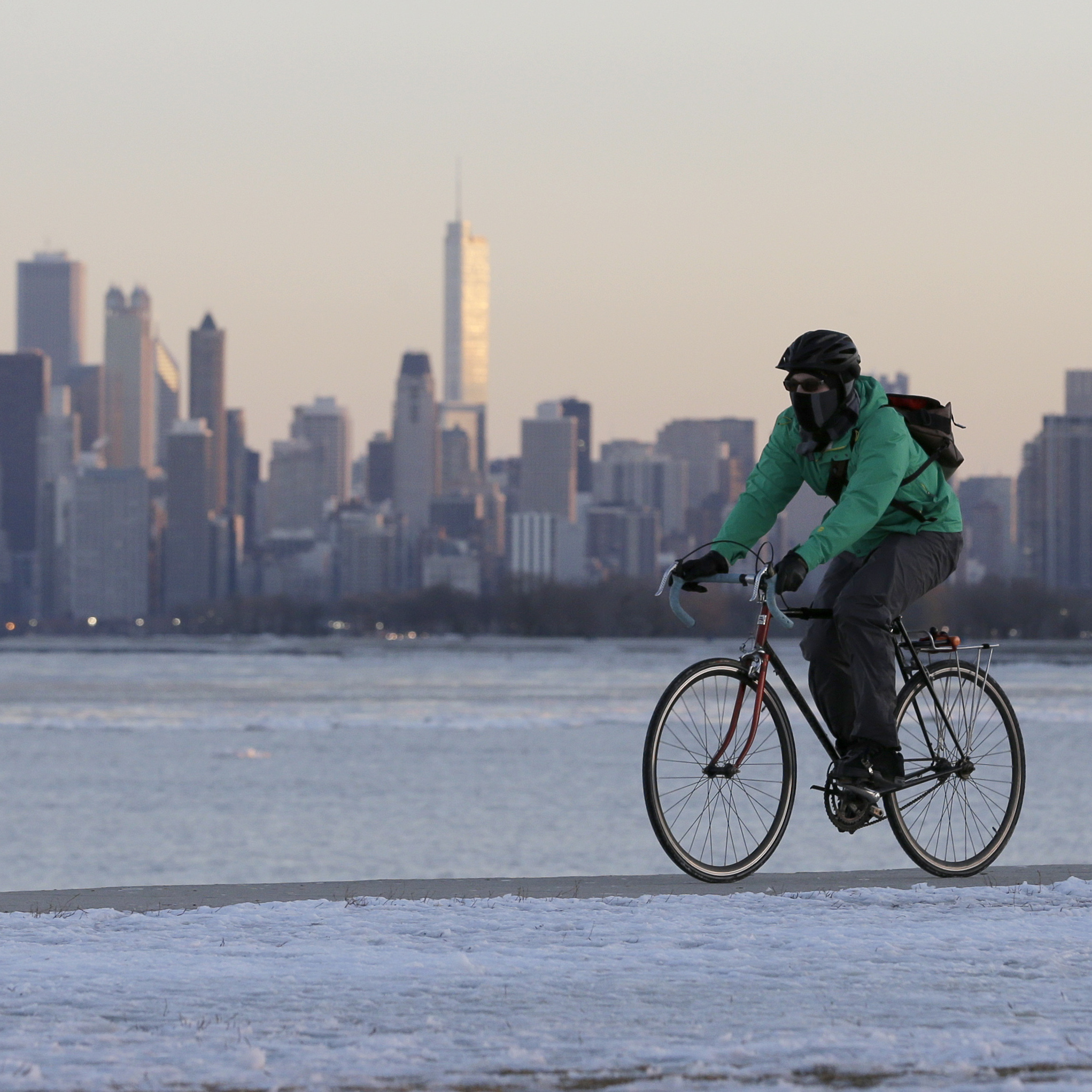 Bundled up: A biker in Chicago this weekend. The city is in the crosshairs of the storm that's going to dump snow across much of the nation.