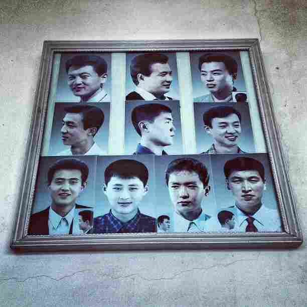 """Example haircuts on display at a barbershop in #Pyongyang."""