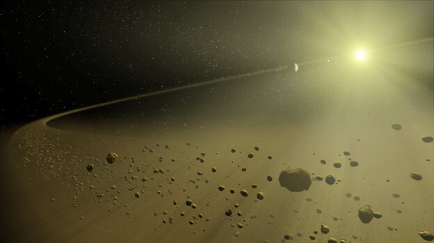 In this illustration, debris along the outer reaches of a planet-forming disk orbits in the glare of a distant sun.