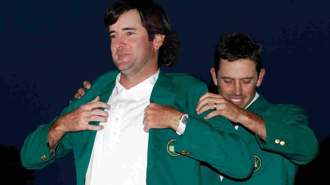 Augusta National says it has long maintained ownership of the green jackets it awards the winners of the Masters Tournament. Here, Bubba Watson accepts his jacket after winning last year's event.