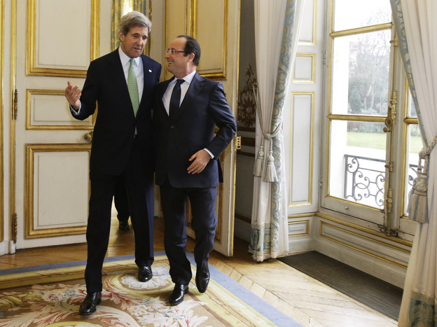 John Kerry, on his first trip abroad as secretary of state, walks with French President Francois Hollande after their meeting at Elysee Palace in Paris on Feb. 27. Kerry's nine-day trip took him through Europe and the Middle East.