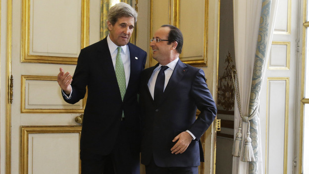 John Kerry, on his first trip abroad as secretary of state, walks with French President Francois Hollande after their meeting at Elysee Palace in Paris on Feb. 27. Kerry's nine-day trip took him through Europe and the Middle East. (AP)
