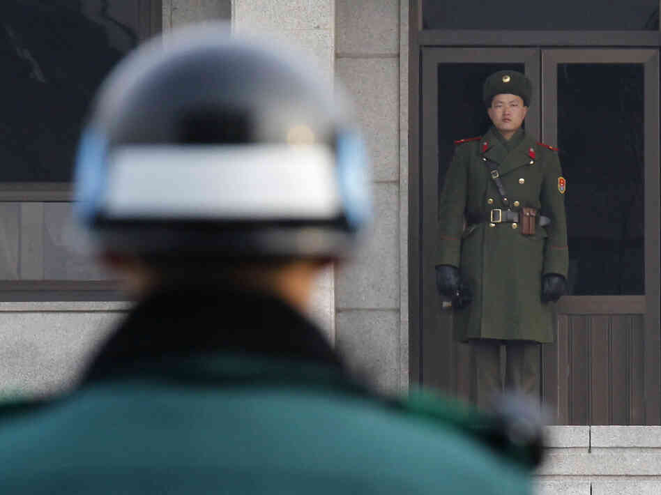 A North Korean (right) and a South Korean soldier facing  each other at the Panmunjom truce village in the demilitarized zone (DMZ) separating the two Koreas in Paju, about 30 miles north of Seoul. (2011 file photo.)