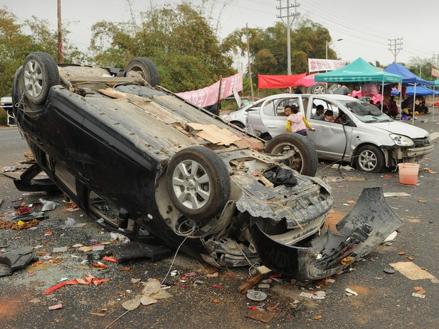 Smashed and overturned cars are shown Saturday after civil unrest in the village of Shangpu in China's southern Guangdong province.