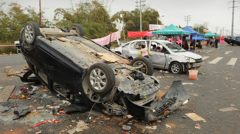 Smashed and overturned cars are shown Saturday after civil unrest in the village of Shangpu in China's southern Guangdong province. (AFP/Getty Images)