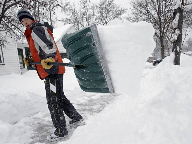 Mike Flynn of Minneapolis was out shoveling snow early Tuesday.