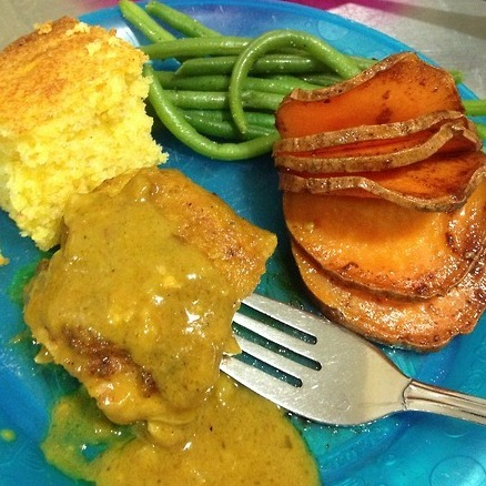"From Dayton, Ohio, TPC shares her dinner: ""Sweet Potatoes with a cinnamon-spiced agave drizzle, served with haricot vert (french green beans), and curried chicken (thighs) and cornbread."""