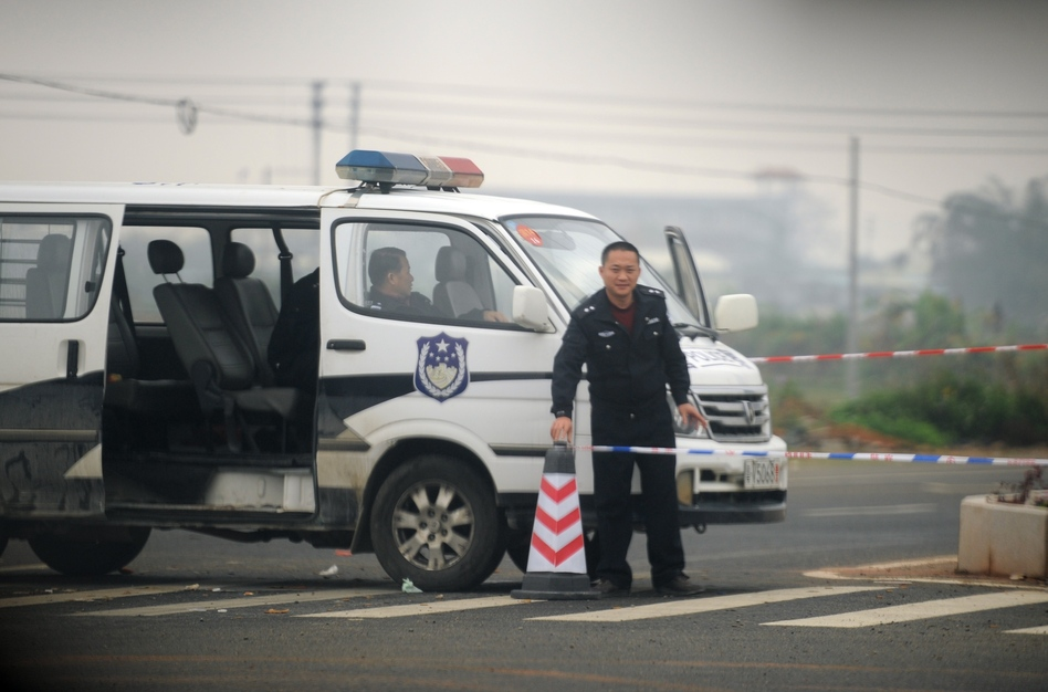 When residents of the southern Chinese village of Shangpu staged an uprising, police set up a roadblock on the main road to keep outsiders away, including reporters. Here, a policeman mans the roadblock on Saturday.