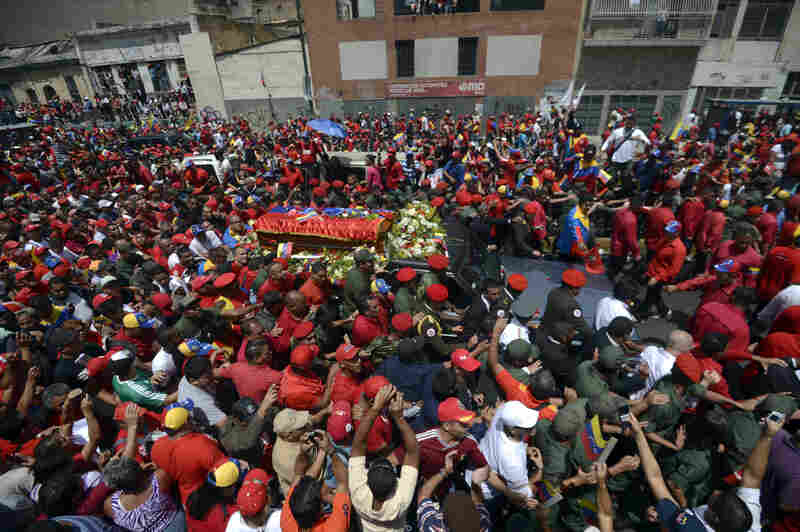 The hearse carrying the coffin of Venezuelan President Hugo Chavez makes its way to the Military Academy amid thousands of supporters, on Wednesday, in Caracas.