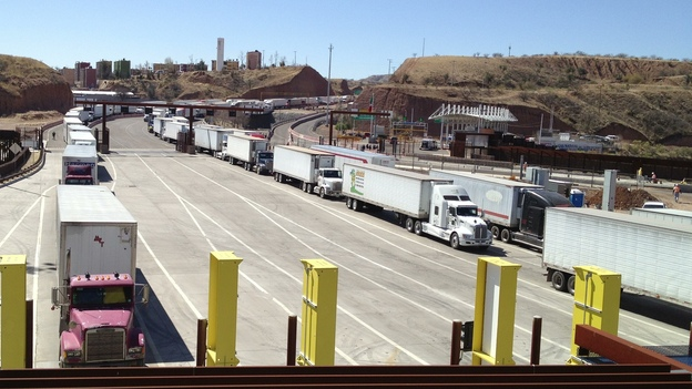Lanes of trucks wait to cross the border from Mexico into Nogales, Ariz. Fallout from the sequester could increase wait times for perishable cargo.