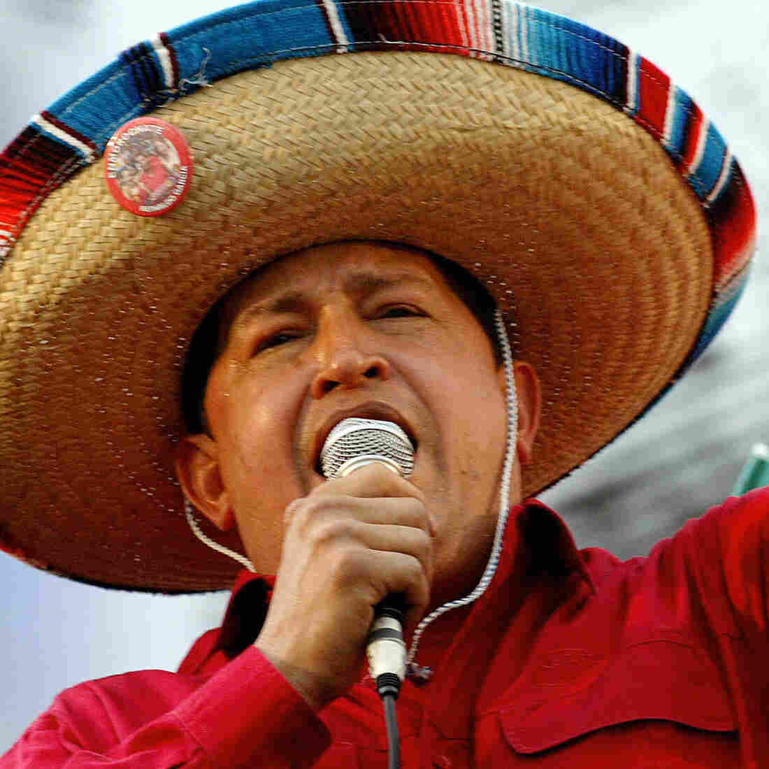Always a showman, Venezuelan President Hugo Chavez, who died Tuesday, sings folk songs with a mariachi group in the capital, Caracas, in 2005.