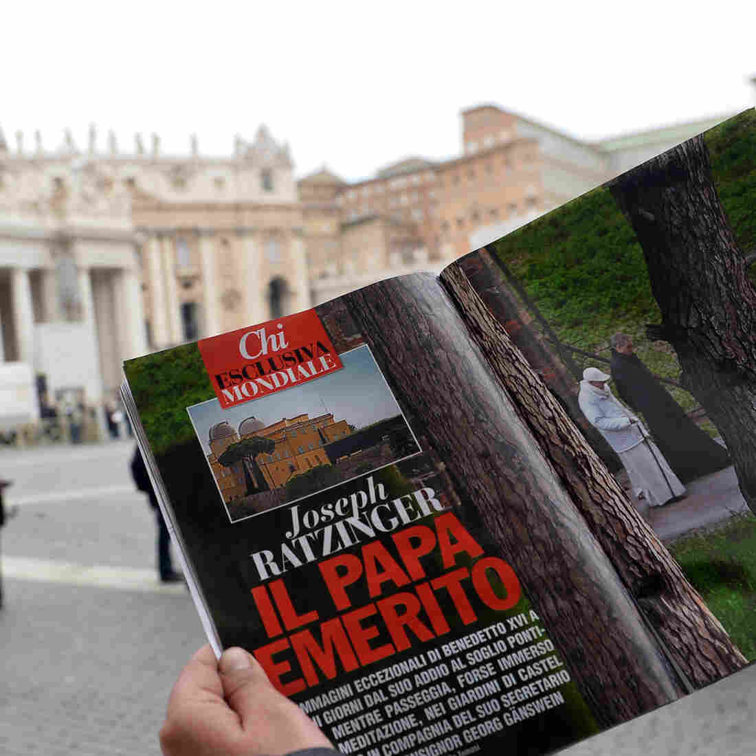 In Vatican City's St. Peter's Square on Wednesday, a man looked at  the Italian magazine Chi's photo of former Pope Benedicxt XVI — the first such image since he stepped down last week.