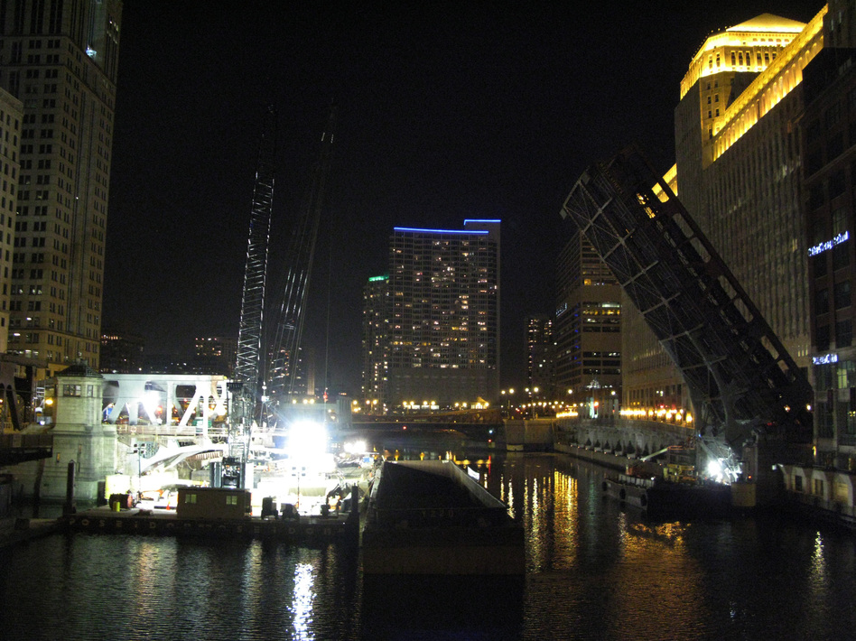 Construction on Chicago's Wells Street Bridge is taking place around the clock, as crews replace the south leaf section. The north leaf section will be replaced in the spring. The double-decked steel truss drawbridge was built in 1922.