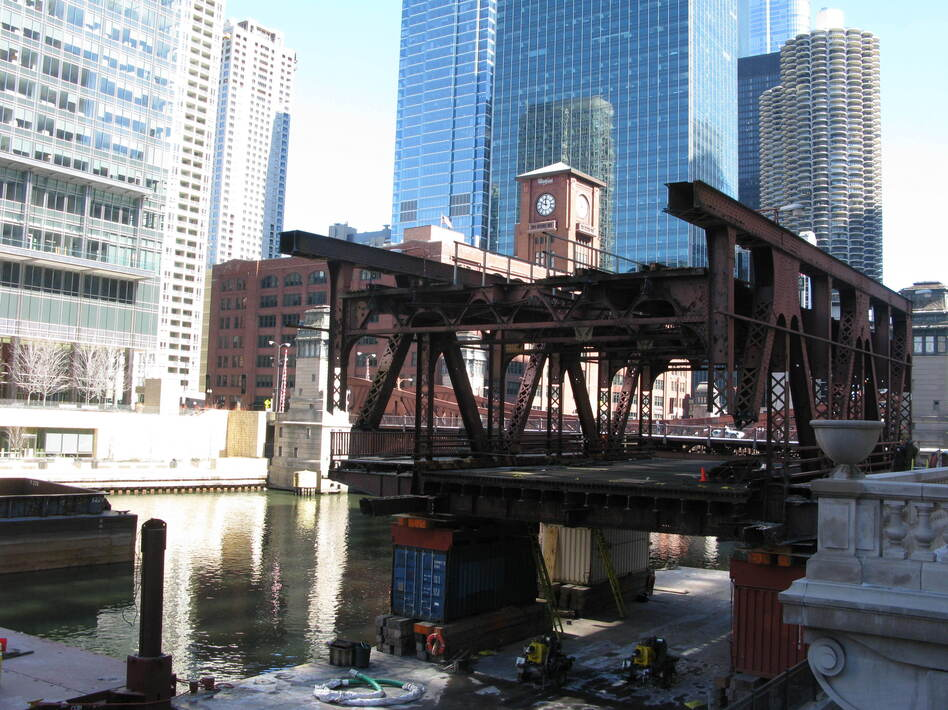 The south leaf section of the Wells Street Bridge in Chicago has been cut off, and will be floated on the river to make way for the replacement section. (NPR)