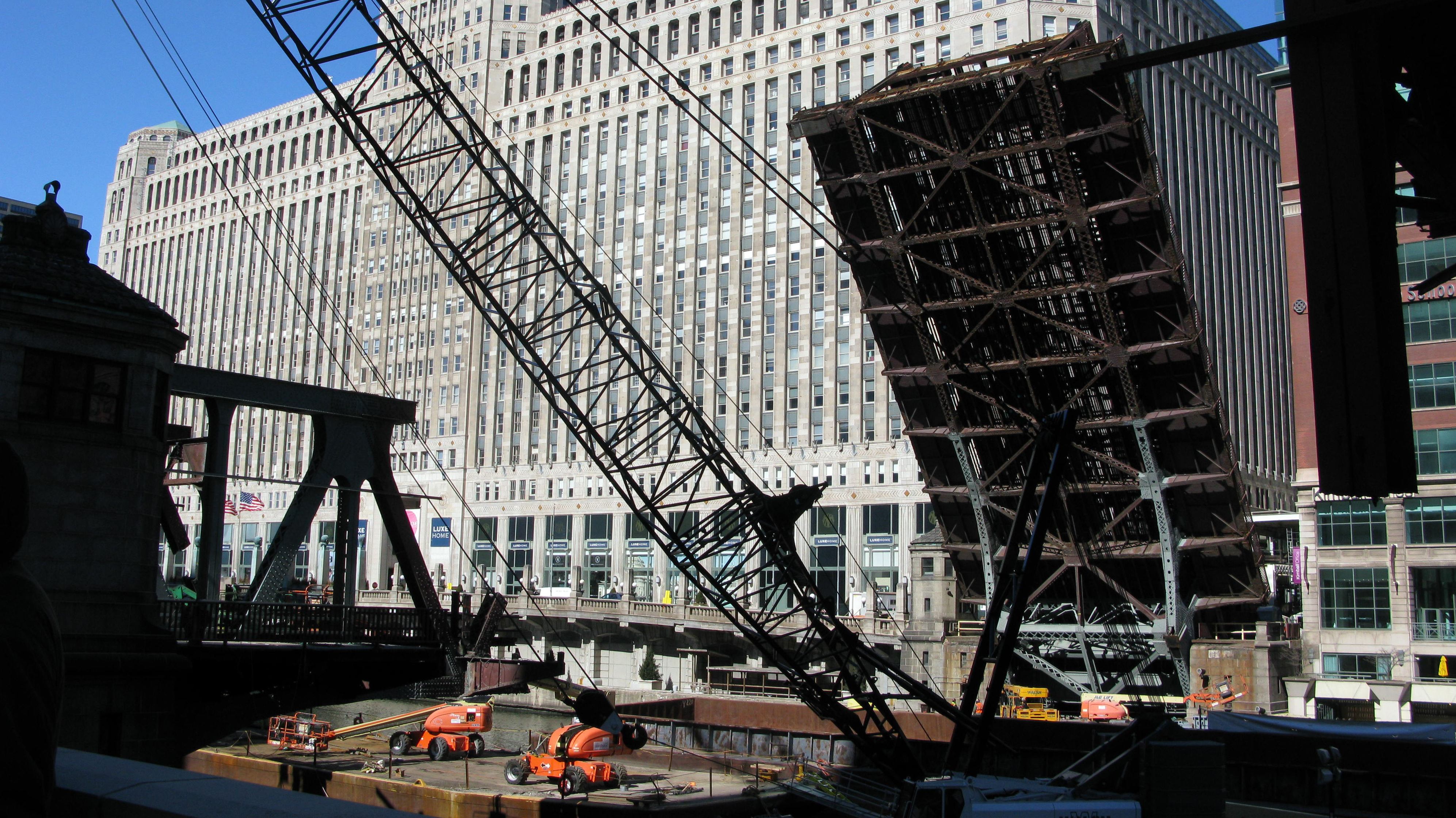 The north leaf section of the draw bridge is suspended in the air during construction. The bridge is considered a Chicago-style trunnion bascule bridge, divided into two sections, each of which is called a leaf. Each leaf goes up and down -- to allow river traffic to pass through -- with the use of 2 million pound counter weights.