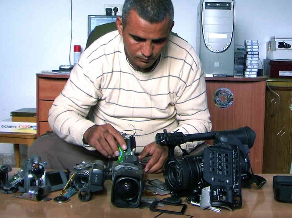 Emad Burnat, a Palestinian who co-directed the Oscar-nominated documentary 5 Broken Cameras, displays the cameras destroyed by Israeli settlers and security forces.