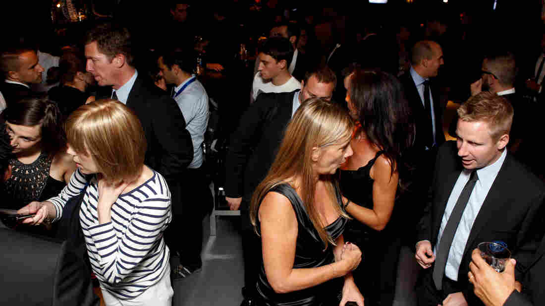 Scientists say that understanding how the cocktail party effect works could help people who have trouble deciphering sounds in a noisy environment. Guests make it look easy at a Dolce and Gabbana Lounge party in London in 2010.