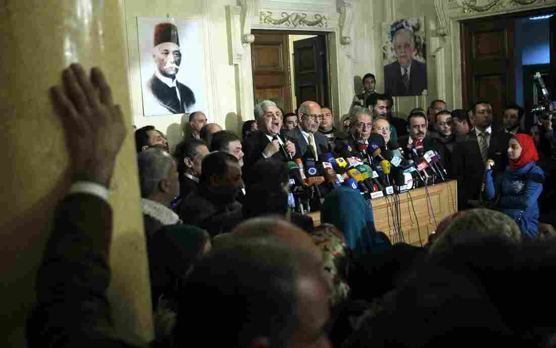 In this Monday, Jan. 28, 2013 file photo, former Egyptian presidential candidate, Hamdeen Sabahi, center left, and former Egyptian foreign minister and Nobel laureate Mohamed ElBaradei, right, speak during a press conference held by Egyptian opposition leaders.