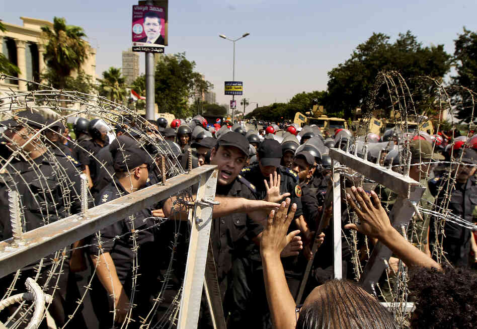An Egyptian military police officer argues with protesters during a demonstration on June 14, 2012, outside the Supreme Constitutional Court in Cairo